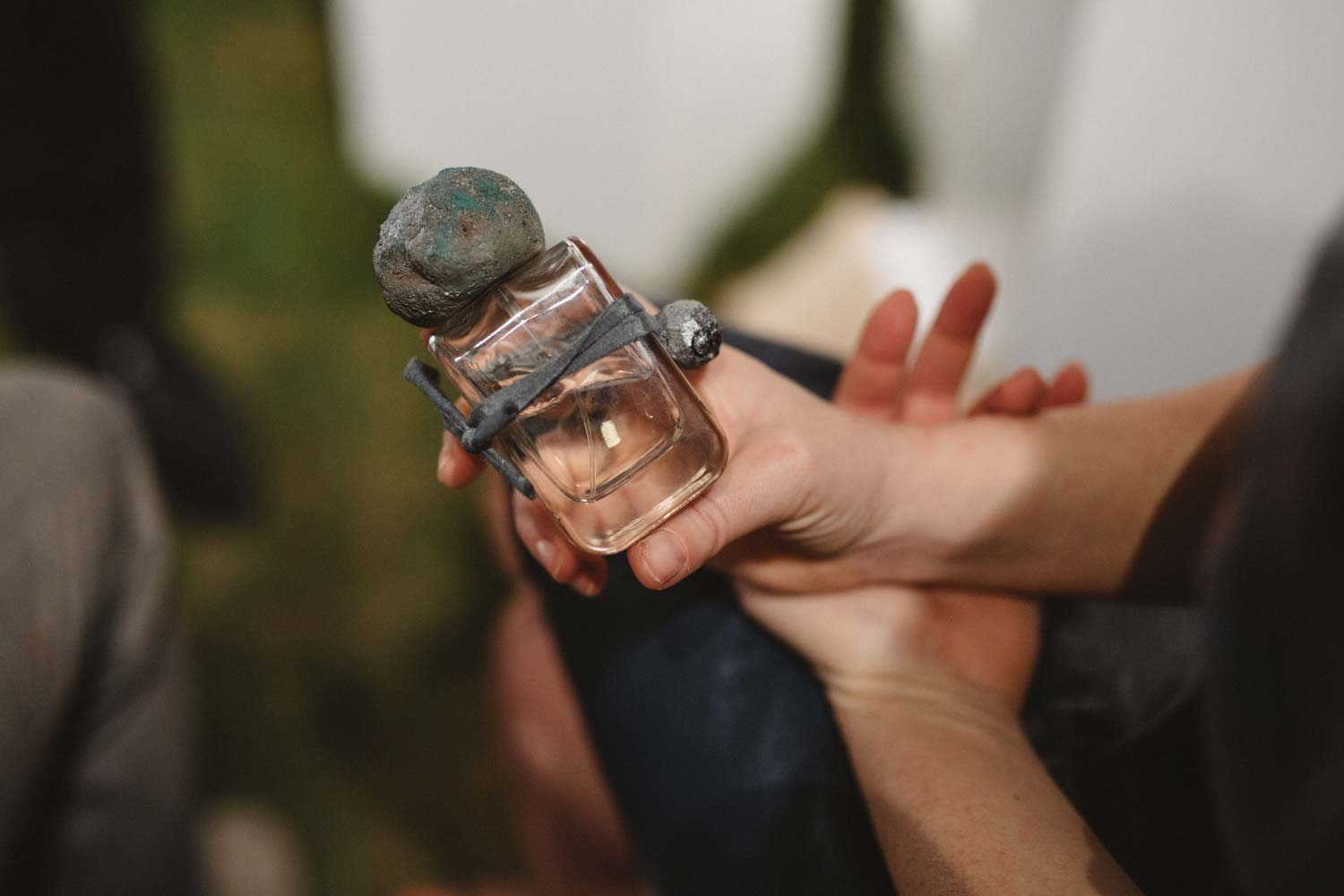 Sirio Extrait de Parfum flacon in glass bottle and hand sculpted cap and charm in Stefania Squeglia hands